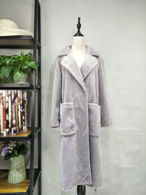 广州伊曼服饰品牌服装尾货批发市场,羊剪绒时尚大衣